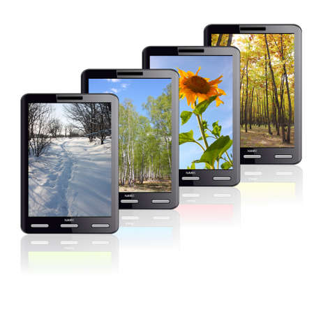 Vertical Tablet computer isolated on the white background. Four different colors stand one by one. Times of the year. photo