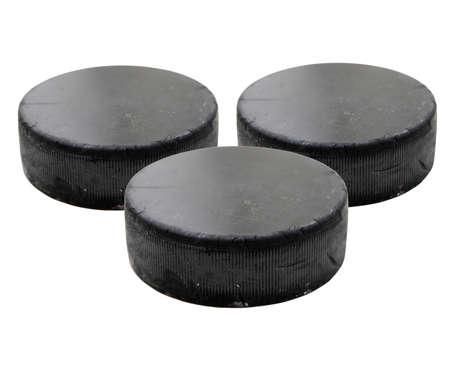 Three old black hockey puck isolated on white background. photo