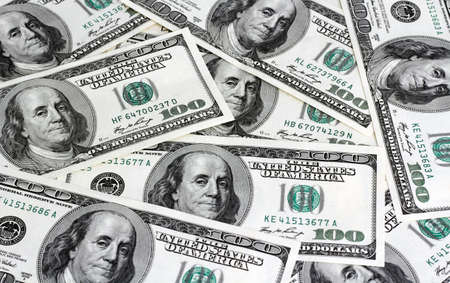 The financial concept of earnings, American dollars, background. photo