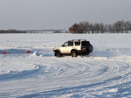 Car on winter road Stock Photo - 12551134