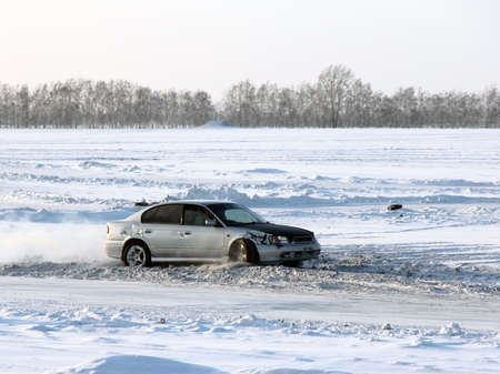 Car on winter road Stock Photo - 12551123