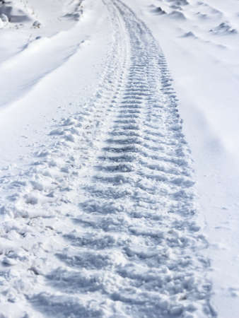 Traces from wheels of the  car on snow photo