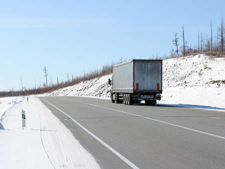 The truck on a winter road. Stock Photo - 12551295