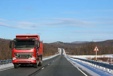 The red truck on a winter road. Stock Photo - 12551334