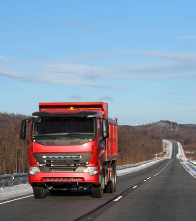 The red truck on a winter road. Stock Photo - 12551018