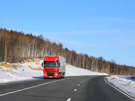 The red truck on a winter road. Stock Photo - 12551192