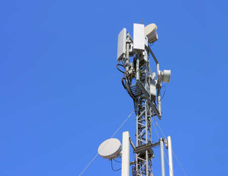 Cellular antenna  against blue sky photo