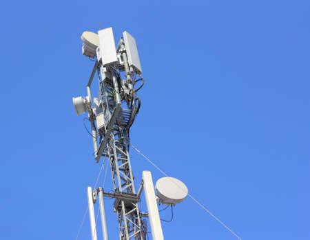 Cellular antenna  against blue sky photo