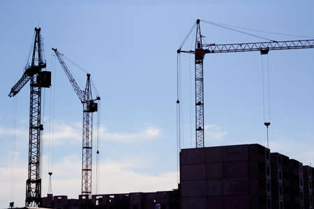 crane and blue sky on building site photo