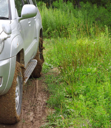 Extreme offroad behind an unrecognizable car in mud Stock Photo - 14802349