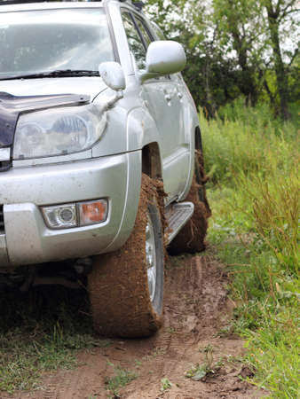 Extreme offroad behind an unrecognizable car in mud Stock Photo - 14802347