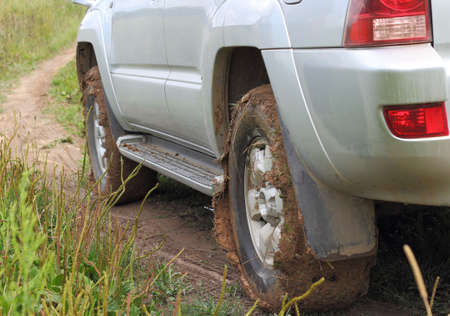 Extreme offroad behind an unrecognizable car in mud photo