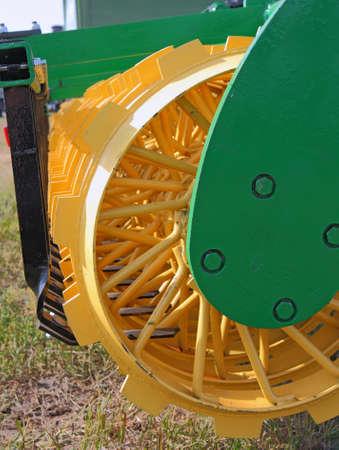 harrow: disc harrow behind tractor turning the soil
