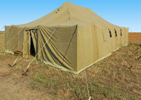 very big military tent in the field Stock Photo