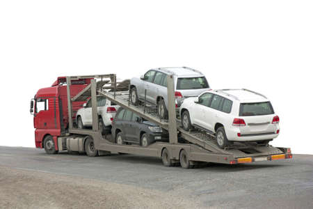 Transporter with cars in the back, on white background  Stock Photo - 17794530