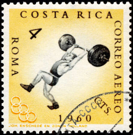 summer olympics: ROMANIA - CIRCA 1960: A stamp printed in the Romania shows weightlifting, Summer Olympics, Roma 60, circa 1960