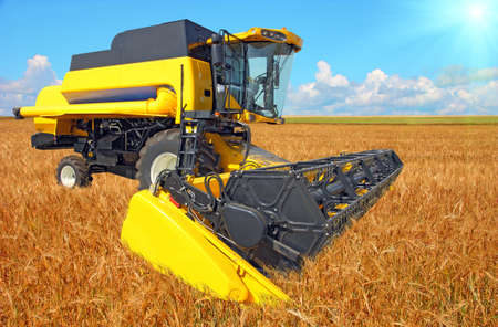 combine harvester on a wheat field with a blue sky Stock Photo - 18197005