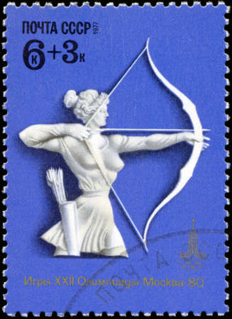 USSR - CIRCA 1977: A stamp, printed in Russia, XXII Olympic games in Moscow in 1980, shows women's archery, circa 1977 Stock Photo - 18193517