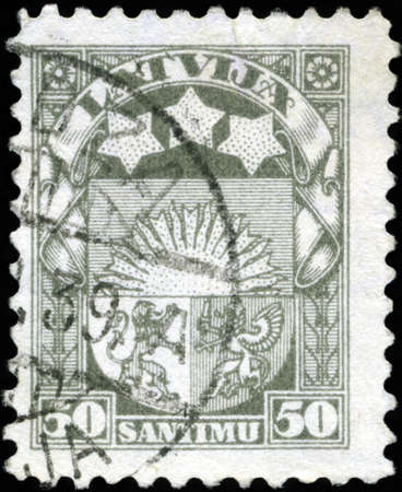 LATVIA - CIRCA 1923: A stamp printed in Latvia shows Latvian Coat of Arms, circa 1923