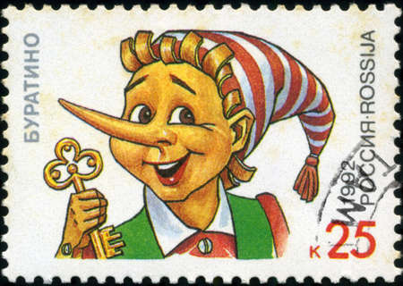 RUSSIA - CIRCA 1992: A stamp printed in Russia shows Pinocchio holding a golden key, series Characters from Children's Books, circa 1992 Stock Photo - 18478238