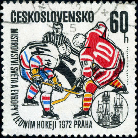 CZECHOSLOVAKIA - CIRCA 1972: A stamp printed in the Czechoslovakia, dedicated to World and European Ice Hockey Championships, Prague, shows two hockey player and hockey referee, circa 1972