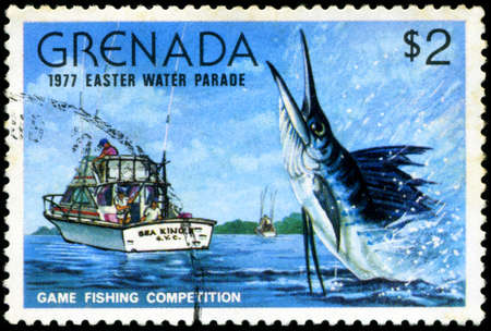 GRENADA - CIRCA 1977: A stamp printed in Grenada issued for the easter water parade  shows game fishing competition, circa 1977. photo