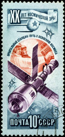 space age: RUSSIA - CIRCA 1977: Stamp printed in USSR (Russia), shows Orbital station in open space, with inscription and name of series 20 years of a space age, circa 1977 Stock Photo