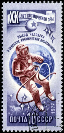 space age: RUSSIA - CIRCA 1977: Stamp printed in USSR (Russia), shows astronaut in open space, with inscription and name of series 20 years of a space age, circa 1977