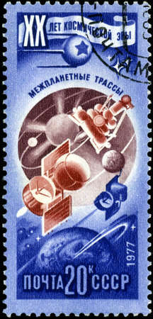 RUSSIA - CIRCA 1977: Stamp printed in USSR (Russia), shows interplanetary routes, with inscription and name of series 20 years of a space age, circa 1977 photo