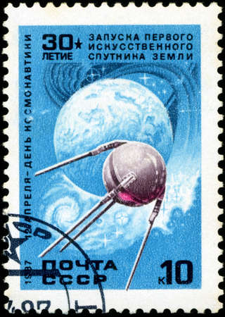 USSR - CIRCA 1987: A stamp printed in USSR , shows launching first satellite of earth, April 12 Day of Cosmonautics , circa 1987 photo