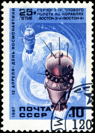 USSR - CIRCA 1987: A post stamp printed in USSR shows Soviet Vostok 3 and Vostok 4 space ships, circa 1987 photo