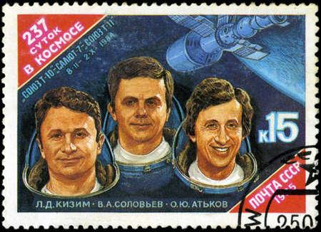 t5: USSR - CIRCA 1985: stamp printed in USSR, shows portraits Cosmonauts L. Kizim, V. Soloviov, O. Atkov and Spacecraft Salyut-7, circa 1985 Editorial