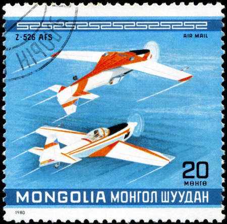 MONGOLIA - CIRCA 1980: A Stamp printed in MONGOLIA shows the Z-526 AFS  Plane, from the series 10th World Aerobatic Championship, circa 1980 Stock Photo