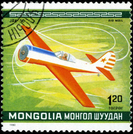 gimmick: MONGOLIA - CIRCA 1980: A Stamp printed in MONGOLIA shows the Jak-50 Plane, from the series 10th World Aerobatic Championship, circa 1980 Stock Photo