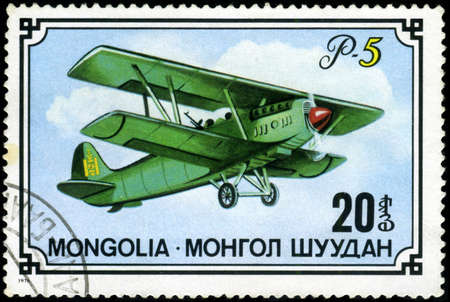 MONGOLIA- CIRCA 1976: A stamp printed in Mongolia shows airplane R-5, series, circa 1976 photo