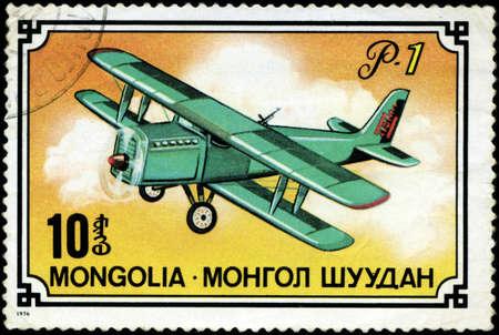 gimmick: MONGOLIA- CIRCA 1976: A stamp printed in Mongolia shows airplane R-1, series, circa 1976 Stock Photo