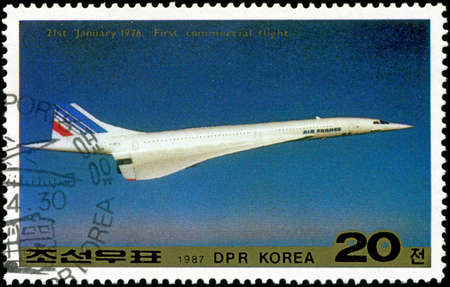 DPR KOREA - CIRCA 1987: A stamp printed in DPR Korea (North Korea) shows Tu-144 and General Designer Tupolev, circa 1987 photo