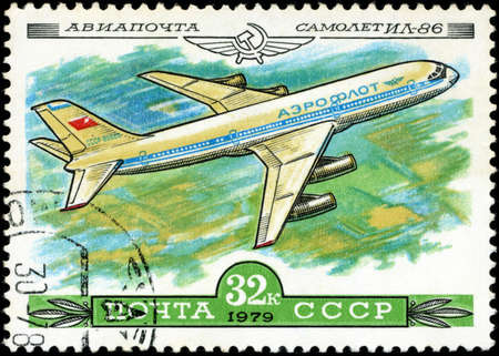 USSR - CIRCA 1979  A Stamp printed in USSR shows the Aeroflot Emblem and aircraft with the inscription  Airmail, Aircraft Il-86 , from the series  History of the Soviet aircraft industry , circa 1979 photo