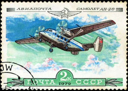 USSR - CIRCA 1979  A Stamp printed in USSR shows the Aeroflot Emblem and aircraft with the inscription  Airmail, Aircraft An-28 , from the series  History of the Soviet aircraft industry , circa 1979 photo