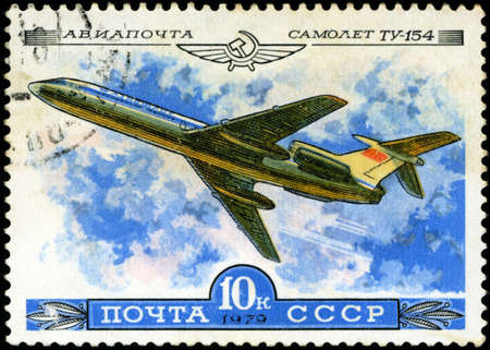 USSR - CIRCA 1979  A Stamp printed in USSR shows the Aeroflot Emblem and aircraft with the inscription  Airmail, Aircraft Tu-154 , from the series  History of the Soviet aircraft industry , circa 1979 photo