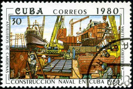 constructing: CUBA - CIRCA 1980  A stamp printed in Cuba shows image shipyard from series  Constructing of ships on Cuba , circa 1980 Stock Photo