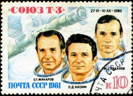 vostok: USSR- CIRCA 1980: A stamp printed in USSR shows the Soviet cosmonauts Makarov, Kizim, Strekalov and a transport spaceship Soyuz-T3 ;, circa 1980 Editorial
