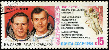 soyuz: USSR - CIRCA 1984: stamp printed in USSR, shows Spacecraft complex Salyut-7 and Soyuz T-9, portraits of cosmonauts V.A Lyahov and A.P.Aleksandrov 150-day flight of Cosmos, circa 1984