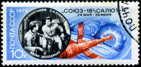 vitaly: USSR - CIRCA 1975: A stamp printed in USSR shows image of the Salyut 4 space station and Soviet cosmonauts Pyotr Ilyich Klimuk (1942) and Vitaly Ivanovich Sevastyanov (1935-2010), circa 1975.