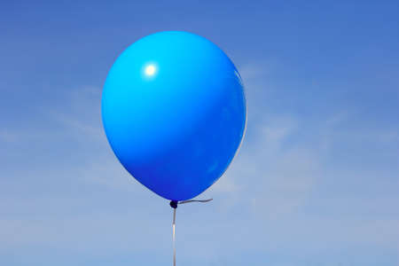 Inflatable balloon, photo on the against the blue sky photo