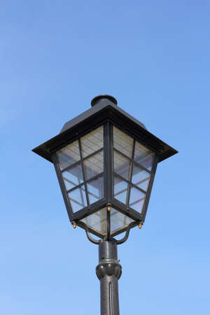 affixed: street lamp against the background of blue sky