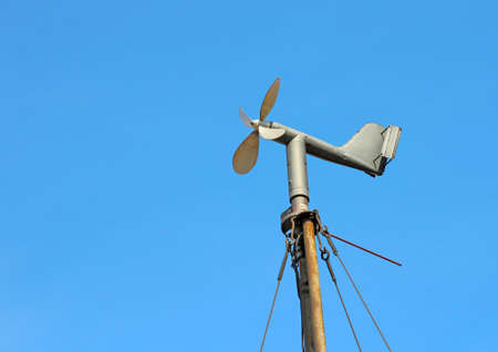 anemometer: Vintage wind mill the background of blue sky