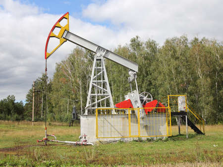 Oil pumpjack. Oil industry equipment. photo