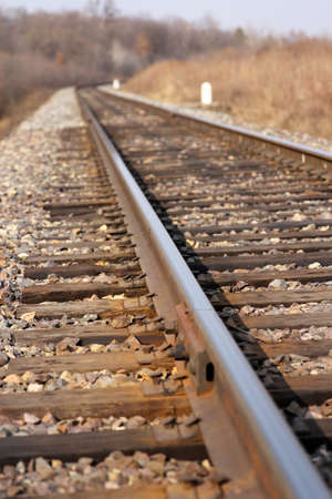 end of a long day: Railway leaving afar to horizon. Stock Photo