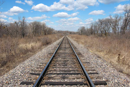 end of a long day: Railway to horizon and clouds on the sky background.